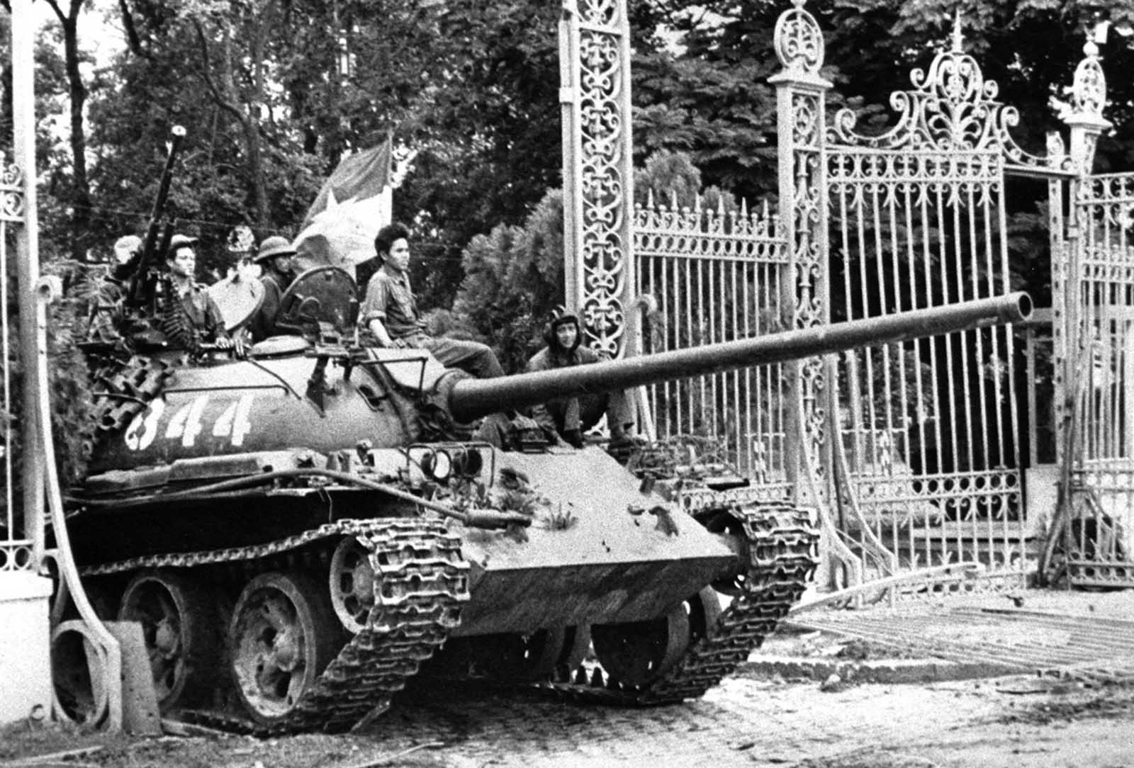 A North Vietnamese tank rolls through the gate of the Presidential Palace in Saigon, April 30, 1975, signifying the fall of South Vietnam. The Socialist Republic of Vietnam was formed in 1976, uniting North and South. Millions of South Vietnamese were sent to reeducation camps, millions more fled the country on their own, leading to the Indochina refugee crisis that lasted another quarter of a century.