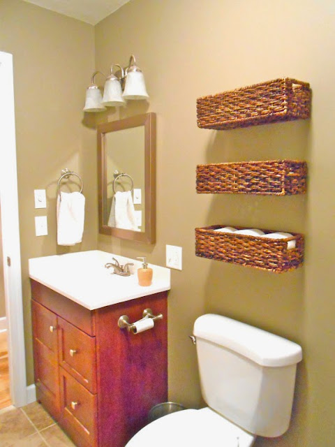 Use baskets for organizing over the toilet in the bathroom:: OrganizingMadeFun.com