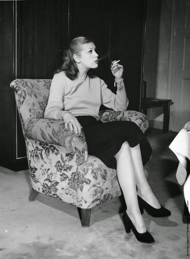 old photos of women smoking cigarettes from the 1930s