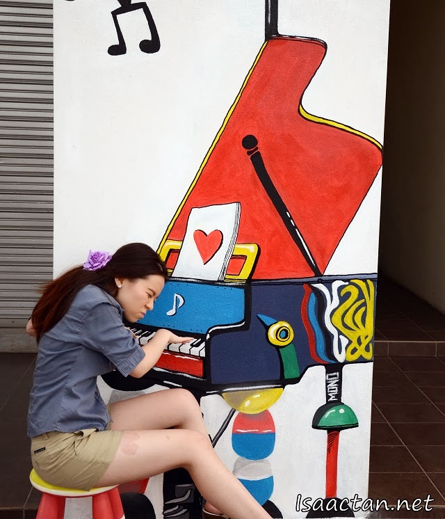 JQ Lee trying her hand playing some beautiful music on the colourful 3D mural art piano