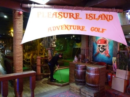Emily teeing-off on hole 1 of the Pleasure Island Adventure Golf course in Whitby