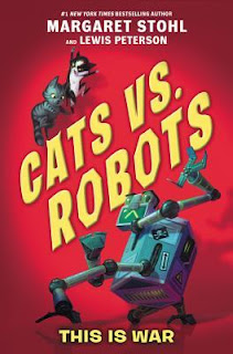 Book cover, Cats vs. Robots, This is War, by Margaret Stohl and Lewis Peterson. Image depicts two cats, positioned above the title letters, looking down at a robot that's beneath the lettering. The robot brandishes claw-like appendages and glares at the cats.