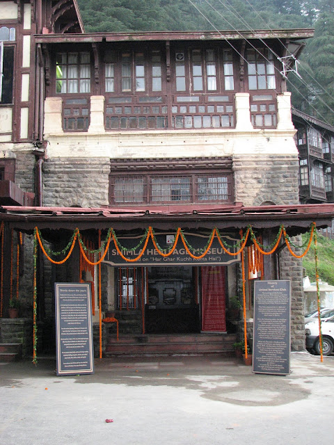 "Shimla Heritage Museum: An eye opener for touristsVandana Bhagra, ShimlaPhotos: By me History can be interesting as well as inspiring and when coupled with life-size images it adds colour to ones imagination. And rather than leaving things to imagination the state tourism department has given shape to it in form of the recently inaugurated 'Shimla Heritage Museum' based on the concept of 'har ghar kuch kehta hai'. Taking a step further this museum is housed in the 120 year old building which is prevalently known as the US Club dating back to almost 1860s, which has been renovated on similar line to the original structure to preserve its wholesomeness. As you enter the building you are reminded of Shimla down the years and a brief write up on the history of the United Service Club is good for enlightenment. The not so huge room inside, though just an attempt to capture the history of Shimla, holds nearly 50 huge portraits and sketches of Shimla dating to the Colonial period. Old timers can definitely associate with all the old building but the young and those visiting for the first time will be left mesmerizing with the beauty and legacy of Shimla. Some of the rare photographs adorning the walls include pictures of magnificent buildings such as the Viceregal Lodge, Rippon Hospital, Post Office, Town Hall, Gaiety Theatre, Combermere Bridge, Vidhan Sabha, Gorton Castle, Railway Board, Central Telegraph Office, the ARTRAC Complex and Barnes Court to name a few. Below the black and white sketches you can see the originals in coloured to give you a feel of the present day.  Dr Arun Sharma, Director Tourism and Civil Aviation says ""Though at present we have very limited space, expansion plans are on anvil as and when we are provided with more space. An attempt has been made to re-discover Shimla's soul and through this museum we wish to fulfill the curiosity of the visitors. Heritage walks, timely tours, a training centre for tourists guides as well as related tourist activities would be taken up simultaneously"". He adds it is time that the heritage status of Shimla is used to maximize economical gains as well as use innovative methods to attract more and more tourist to the states and also prolong their stay. Sharma said, ""The department has started the Shimla City Tour in association with the Tourism Industry Stakeholders Welfare Society, Shimla through which heritage walks would begin in the city"". Taking this concept further he says, ""We are planning on adopting one village in each district which will be promoted as a tourist destination by opening similar kinds of museums eerywhere"".Surender Justa, District Tourism Development Officer, added that this is just a beginning of better things to come. ""Initiatives are being taken to promote this museum as well as Shimla City as a heritage destination. Banners and signage's are being put up on the streets to inform the tourist about this place. At the same time guides are being given training to help tourists. Despite the fact that it is just a one room museum, expansion plans are on"".In spite of the fact that this museum is a one room show but perceptions and insights will definitely change once you walk around. You may have heard stories about the old 'tongas', the 'rikshaw' or the styles and glory in which the Britishers lived, which you can easily picturize through the portraits and sketches placed here. A must stop over to complete your visit to Shimla and take some amazing memories."