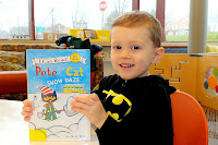 Boy holding a Pete the Cat book