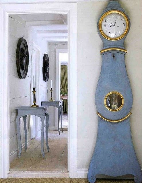 Blue antique Swedish tables and Mora clock - found on Hello Lovely Studio