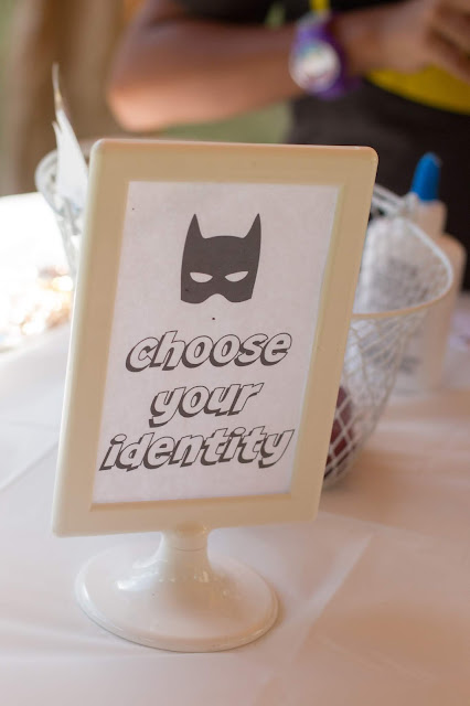 Choose your identity sign for decorating masks at a superhero party