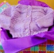 http://translate.googleusercontent.com/translate_c?depth=1&hl=es&rurl=translate.google.es&sl=en&tl=es&u=http://www.countrywomanmagazine.com/project/knitted-lavender-baby-sweater/&usg=ALkJrhhGYFp3Bidx7v7cfnrDLwqcXEYhbw