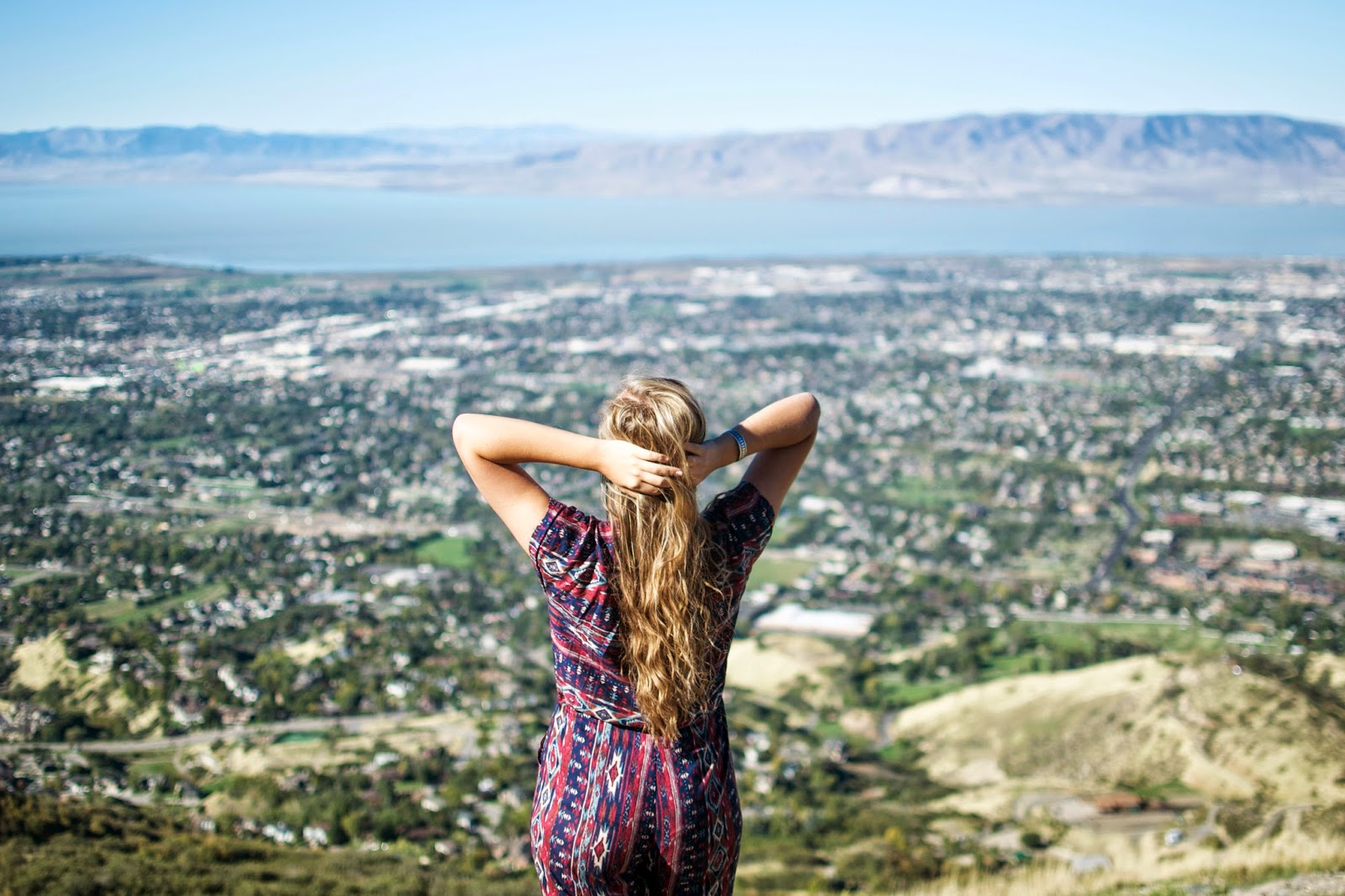 girl jumpsuit on top of squaw peak utah