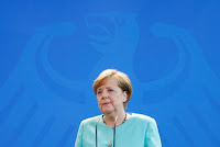 German Chancellor Angela Merkel delivers a statement about Trump's global climate deal announcement at the Chancellory in Berlin, Germany, June 2, 2017. (Credit: Reuters/Fabrizio Bensch)