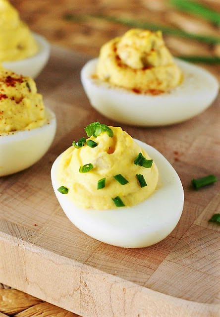 Deviled Eggs Garnished with Chopped Chives Image