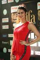 Meenakshi Dixit in Red One Shoulder Red Zipped up gown at IIFA Utsavam Award 68.JPG