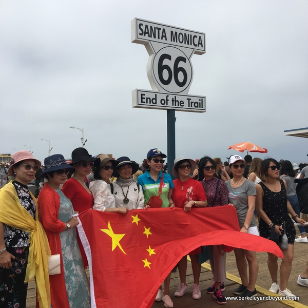 tour group from Wenzhou, China at the Route 66 sign on the Santa Monica Pier in Santa Monica, California