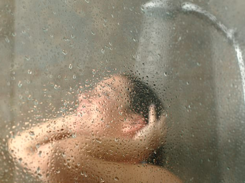 Showering At Night Benefits/Bustle
