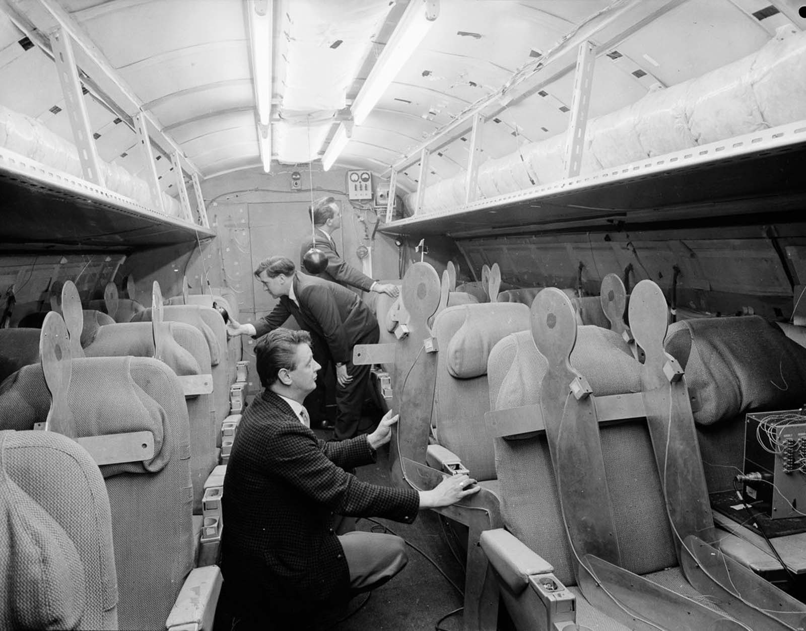 Designers and passenger stand-ins in the cabin of the Concorde. 1964.