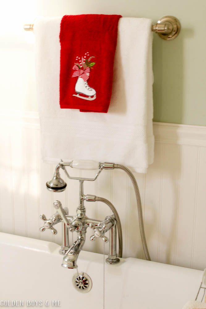HomeGoods holiday towel with ice skate in master bathroom