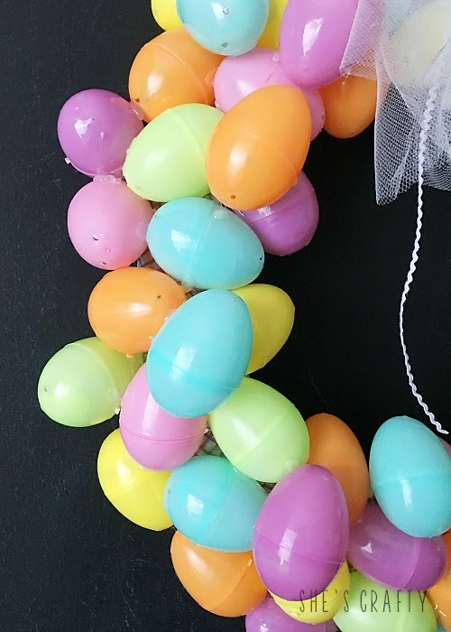 Pastel Easter Egg Wreath DIY - use glue gun to glue plastic eggs to wreath form