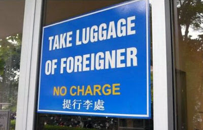 Funny Signs Take Luggage of Foreigner