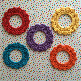 Five crochet frames in a range of colours