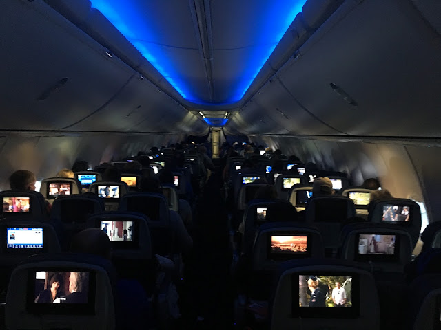 inside of airplane with lights down