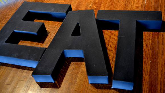 Basic cardboard letters painted with a base coat are all you need to recreate pricey zinc letters from Anthropologie