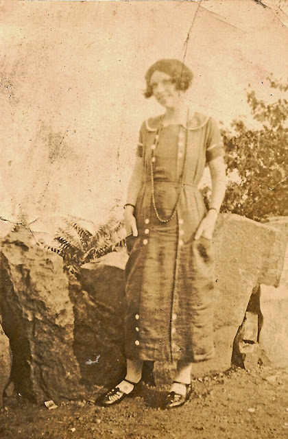 Mystery Photo Monday : unidentified young woman standing in front of large rocks. Possible connection to Estelle Karvoius and Elizabeth, NJ.