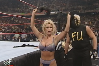 WWF -  Unforgiven 1998: In Your House 21 - Sable celebrates stripping Luna Vachon in an evening gown match