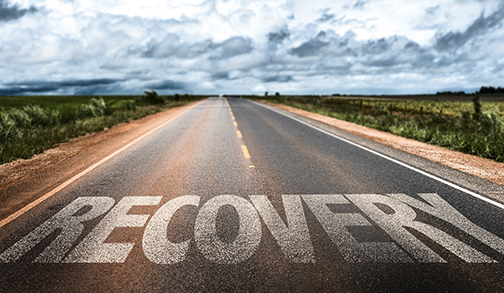 "image of a highway.  ""Recovery"" is etched into it."