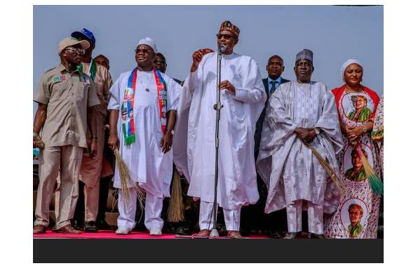BREAKING: Another Faux Pas! Buhari Hands Over APC Flag To 'Our Governortorial Candidate'