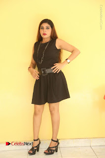 Tollywood Upcoming Actress Pooja Roshan Stills in Black Short Dress at Plus 1 Movie Trailer Launch  0233.JPG