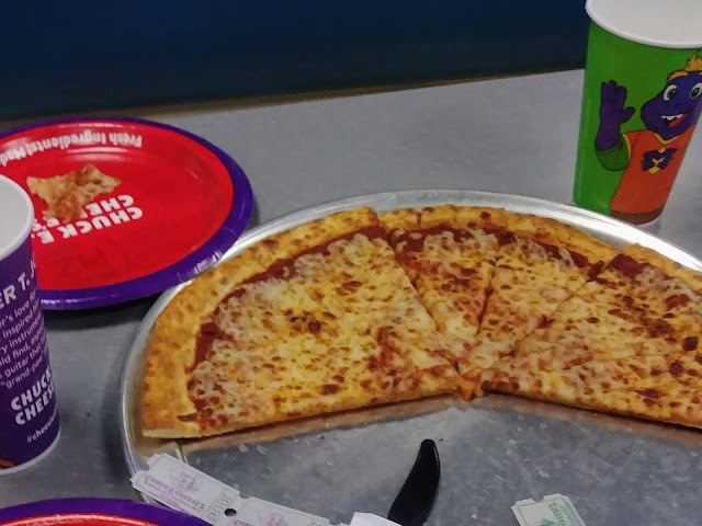 Eating made from scratch pizza at @ChuckECheese