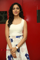 Actress Ritu Varma Stills in White Floral Short Dress at Kesava Movie Success Meet .COM 0039.JPG
