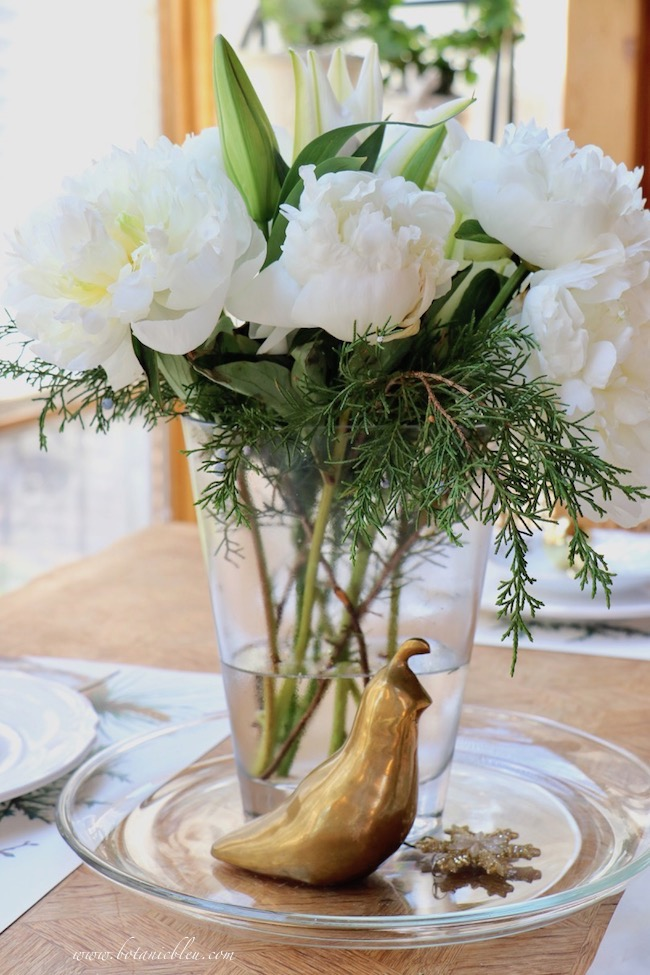 white Christmas peonies with native cedar branches for a French table setting