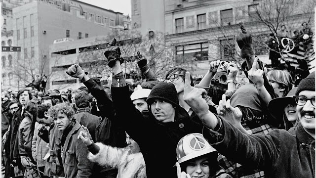There were massive protests in 1973 at Richard Nixon's second inaugural. Protesters flipping off nixon. Misspelled Impeach. marchmatron.com