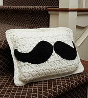 http://www.redheart.com/free-patterns/mustache-pillow