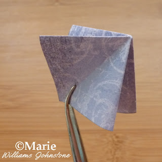 folded square of tea bag paper