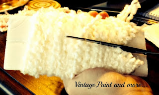 Vintage, Paint and more... cutting the yarn wrapped around the cardboard template to make pom poms for a yarn wreath