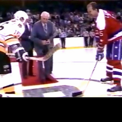 Milt, who won four Cups in Boston and 11 games total in Washington, drops the ceremonial puck at a 1987 B's-Caps game. Rod Langway looks on.