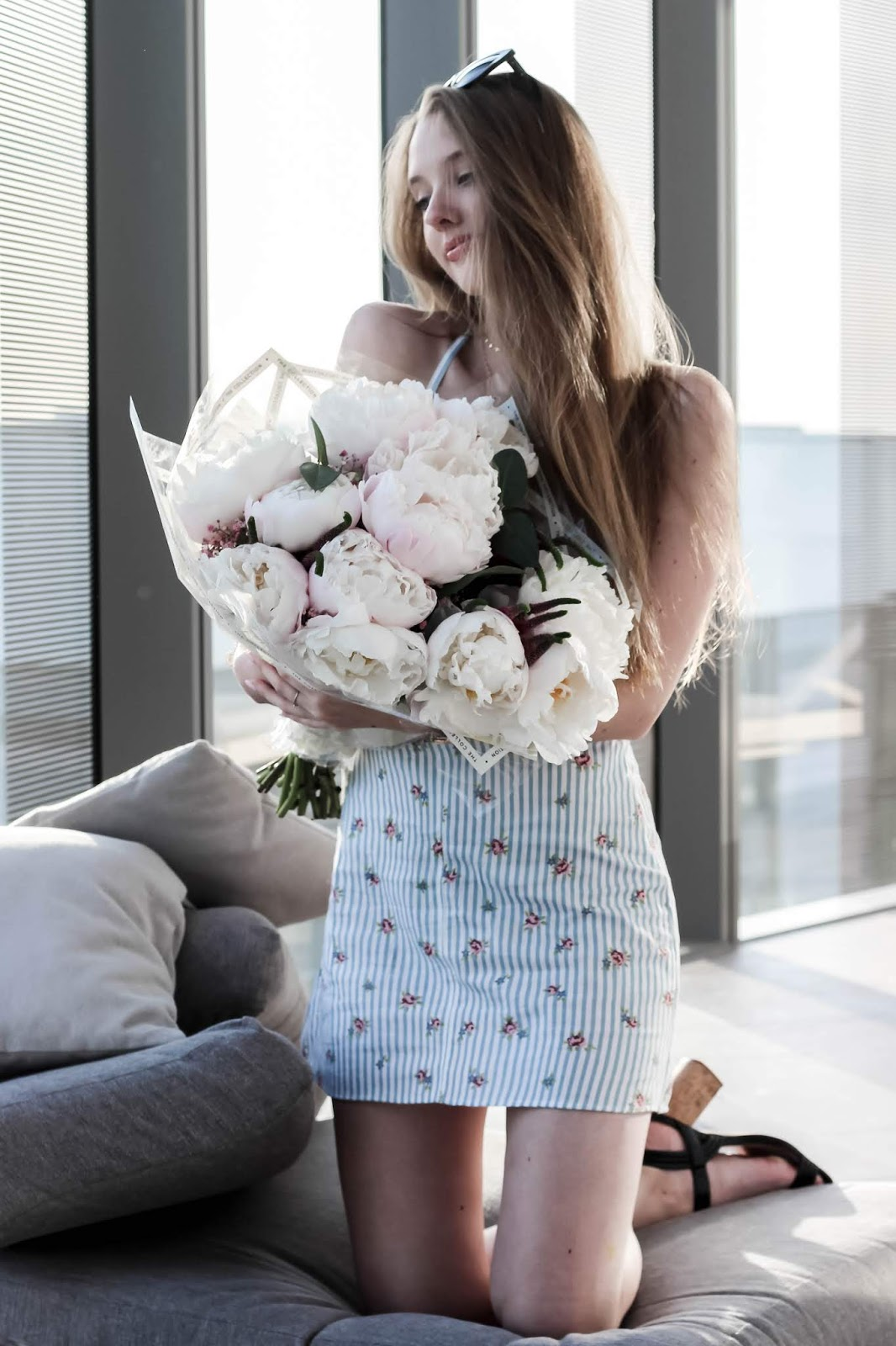 Fashion Blogger Holding Bouquet of Pink Peonies