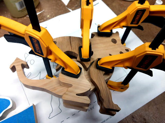Handmade Wooden Toy Baby Dragon in the Clamps