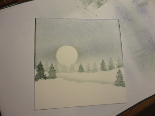 Snowy landscape with moon and trees