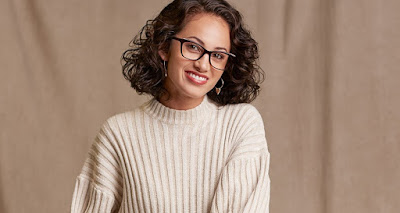 K'Mich Weddings - wedding planning - eye wear - lady in white sweater wear sparkle eye wear