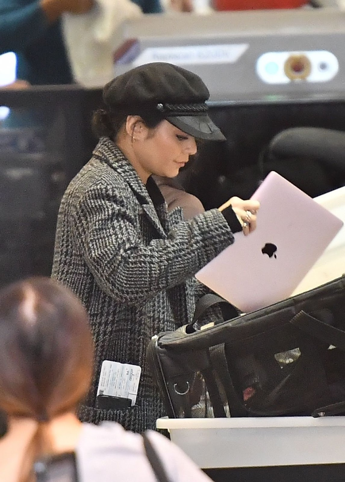 Photos of Vanessa Hudgens without makeup with her dog at Los Angeles International Airport