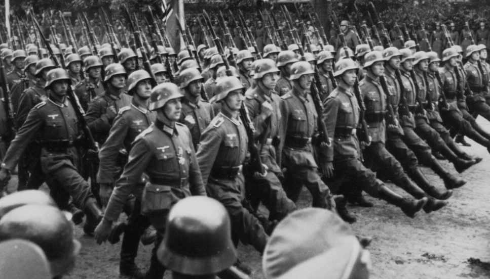 German troops march through occupied Warsaw, Poland, during World War II, circa 1939