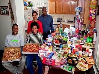 A family displaying a wide variety of foods they are accustomed to.