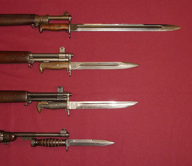 U.S. military bayonets; from the top down, they are the M1905 Bayonet, M1 Bayonet, M1905E1 Bowie Point Bayonet (cut down version of the M1905), and the M4 Bayonet for the M1 Carbine.