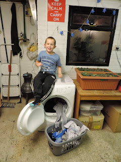 boy sitting on tumble clothes dryer lindo300 zanussi