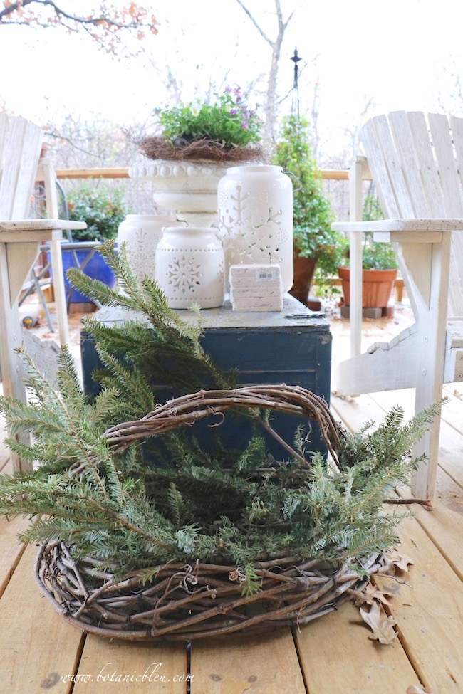 winter-porch-rustic-basket-evergreens