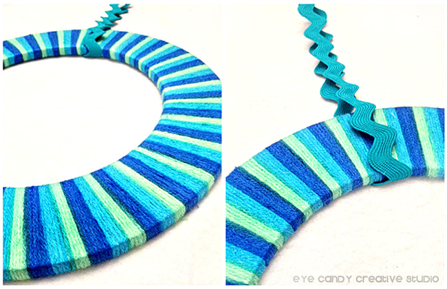 how to make a yarn wreath, ribbon, glue, yarn, wreath form, blues and greens