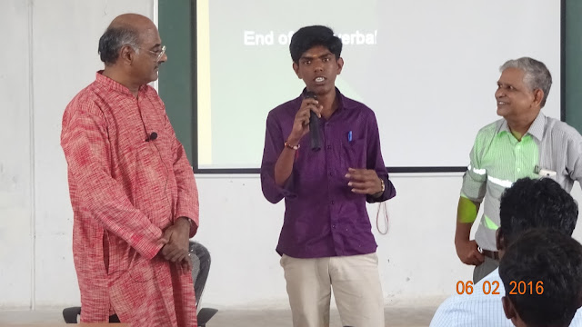Prime Point Srinivasan (extreme left) and Dr R Jagannathan (extreme right) helping a student to make a good presentation