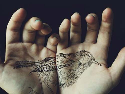 bird tattoo on palm avuç içi kuş dövmesi